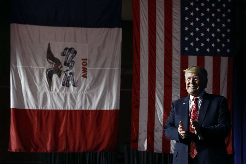 Donald Trump wearing a suit and tie: President Donald Trump arrives to speak at the Republican Party of Iowa's annual dinner June 11, 2019, in West Des Moines.
