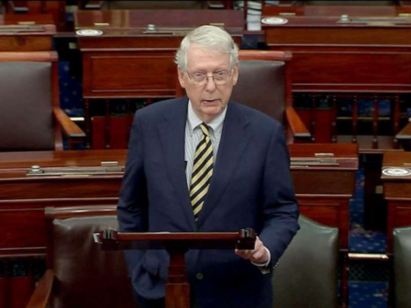Mitch McConnell wearing a suit and tie sitting in a chair: Republican Senator Mitch McConnell speaks on the floor of the Senate in Washington, Sept. 21, 2020.