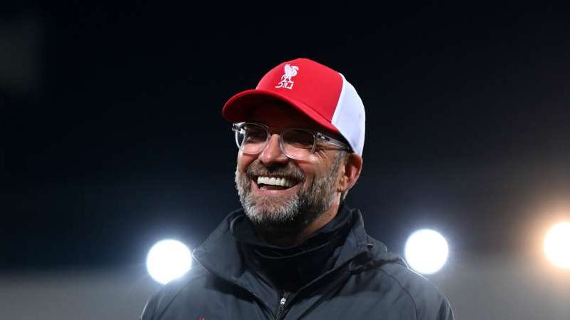a man wearing a hat and glasses: Jurgen Klopp was pleased with Liverpool's display against Arsenal