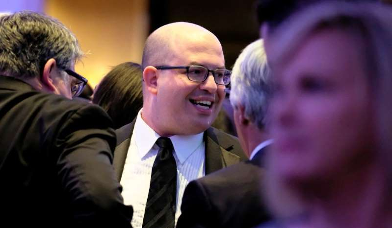 a man wearing a suit and tie: Brian Stelter of CNN mingles at the annual White House Correspondents Association Dinner in Washington, D.C., April 27, 2019.