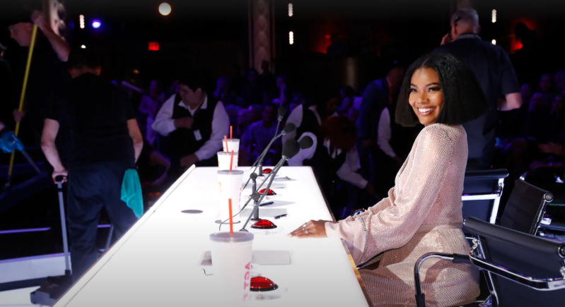 Gabrielle Union et al. sitting at a table