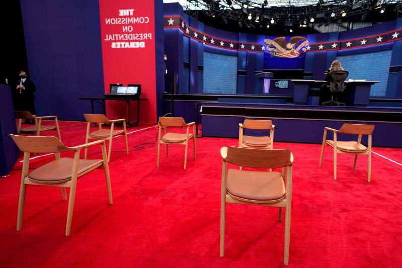 a dining room table: Chairs spaced for social distancing ahead of the first presidential debate between President Donald Trump and former Vice President Joe Biden.