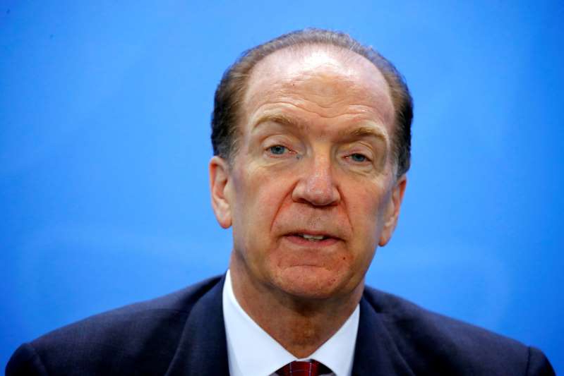 David Malpass wearing a suit and tie smiling at the camera: FILE PHOTO: World Bank Group President Malpass attends news conference after meeting at Chancellery in Berlin