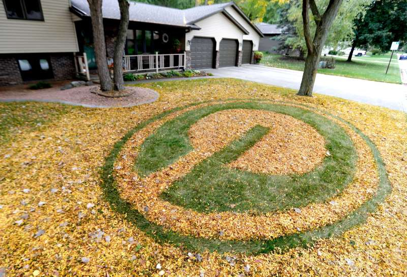 Green Bay resident Charlie Nitka raked his fall leaves into a Packers logo in his front yard.