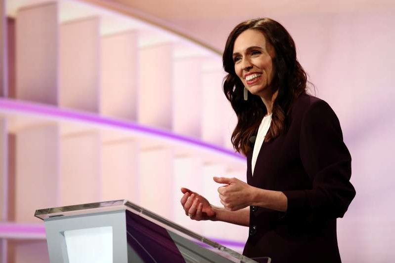 Jacinda Ardern standing in front of a computer: FILE PHOTO: New Zealand Prime Minister Ardern participates in a debate in Auckland