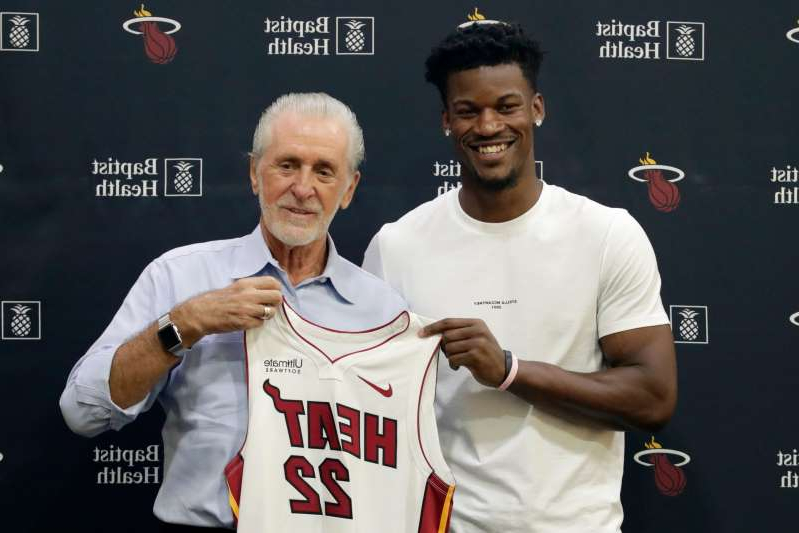 Jimmy Butler, Pat Riley are posing for a picture: Pat Riley brought Jimmy Butler to Miami in a sign-and-trade during the offseason.