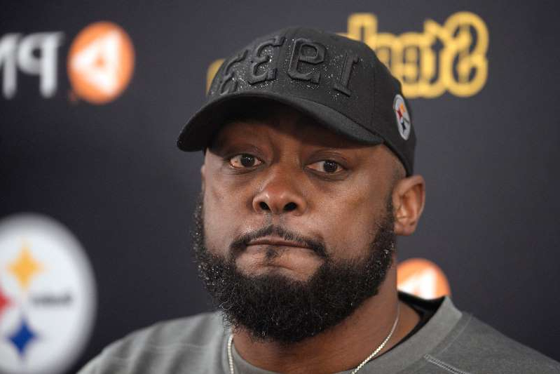 Mike Tomlin wearing a hat: FILE - In this Dec. 29, 2019, file photo, Pittsburgh Steelers head coach Mike Tomlin speaks to reporters after an NFL football game against the Baltimore Ravens in Baltimore. While Steelers head coach Mike Tomlin is encouraged by the fact no players have opted out of the 2020 season, he's also wary the season will be able to go without interruption amid the COVID-19 pandemic. (AP Photo/Nick Wass, File)