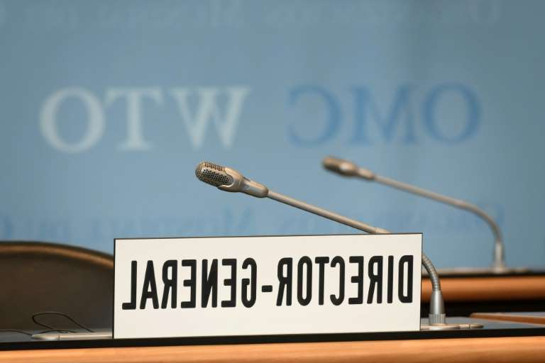 a close up of a sign: The World Trade Organization aims to chose a new director-general in November