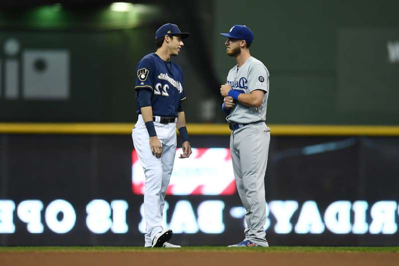 a group of baseball players standing on top of a field: Former NL MVPs Cody Bellinger of the Dodgers, left, and Christian Yelich of the Brewers faced each other in the 2018 NLCS.
