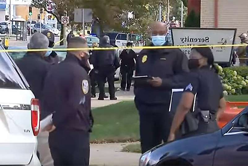 a group of police officers riding on the back of a car: youtube Shooting in Milwaukee