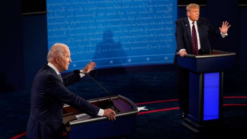 a man in a suit and tie: President Trump interrupted opponent Joe Biden more than 70 times in the first debate