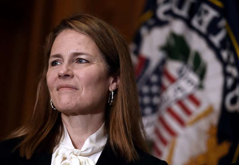 a man wearing a suit and tie: Judge Amy Coney Barrett, President Donald Trump's nominee for the Supreme Court. OLIVIER DOULIERY/POOL/AFP via Getty Images