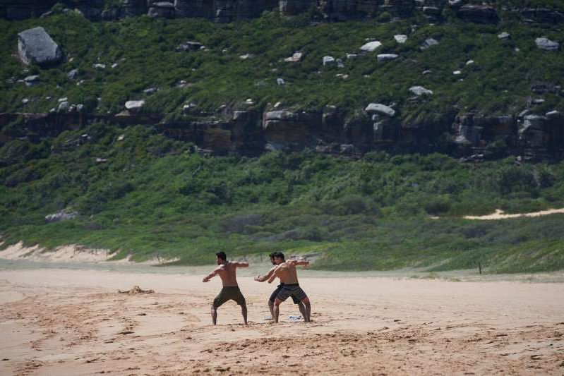 a person playing frisbee on the beach: Nikau, Ari and Tane Parata perform a haka in Home and Away