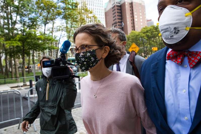a person wearing a suit and tie talking on a cell phone: Clare Bronfman, 41, the youngest daughter of former Seagram chairman Edgar M Bronfman, had pleaded guilty in April 2019 to her involvement in an organisation that allegedly manipulated, enslaved and blackmailed its members [Paul Frangipane/Bloomberg]