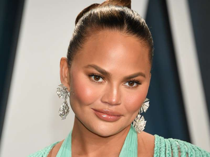 Chrissy Teigen smiling for the camera: Getty
