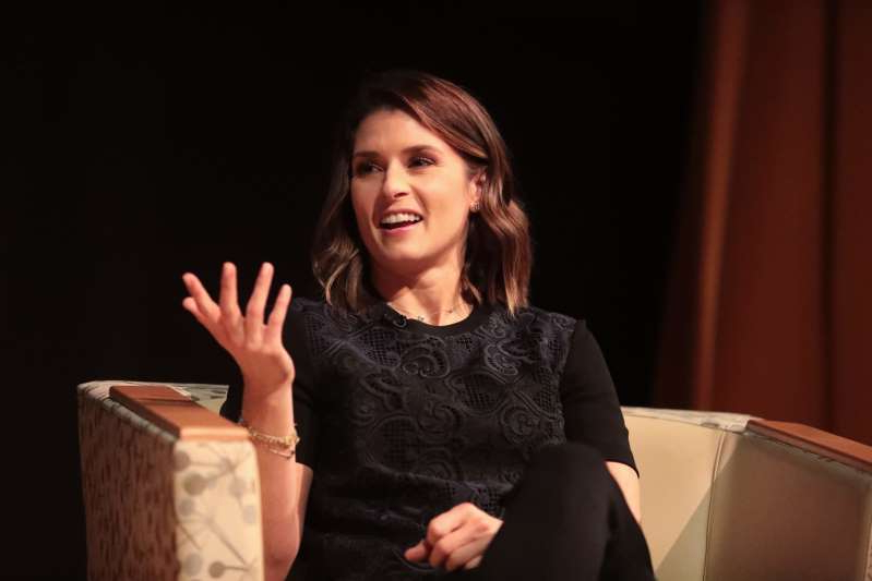 Danica Patrick sitting on a table: Danica Patrick talks dating.