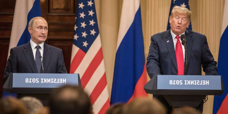 Donald Trump, Vladimir Putin are posing for a picture: US President Donald Trump (L) and Russian President Vladimir Putin speak to the media during a joint press conference after their summit on July 16, 2018 in Helsinki, Finland. Chris McGrath/Getty Images