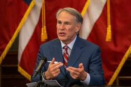 Greg Abbott wearing a suit and tie: Texas Governor Greg Abbott announces the reopening of more Texas businesses during the COVID-19 pandemic at a press conference at the Texas State Capitol on May 18, 2020 in Austin, Texas. On Thursday, Abbott announced that counties in the state would only be allowed on drop-off location for mail-in ballots per county.