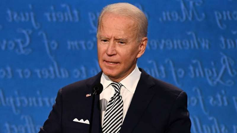 Joe Biden wearing a suit and tie: Democrats say Biden survived brutal debate — and that's enough
