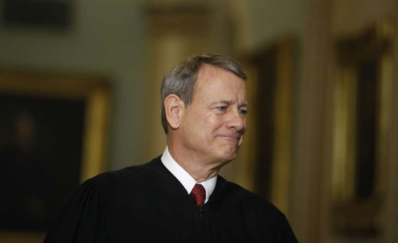 John Roberts wearing a suit and tie