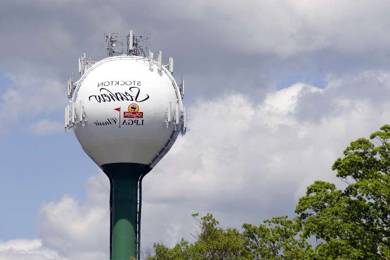 a pole that has a sign on a cloudy day: ShopRite LPGA