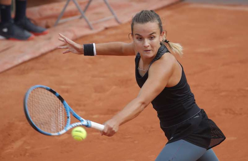 a woman hitting a ball with a racket: French Open
