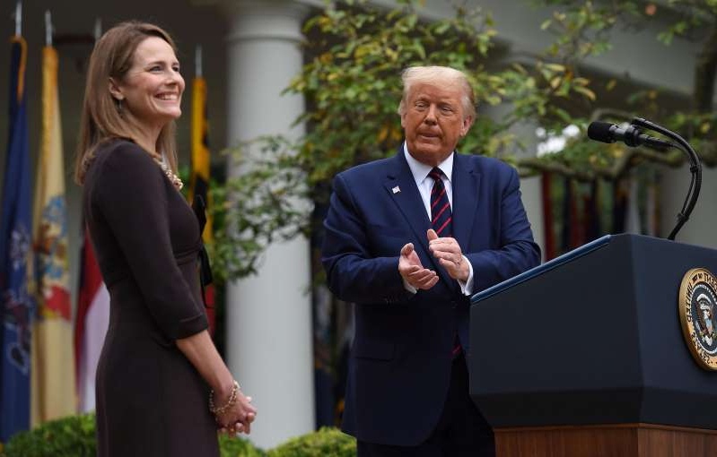 Donald Trump wearing a suit and tie: President Donald Trump announces Judge Amy Coney Barrett as his U.S. Supreme Court nominee on Sept. 18 in Washington.