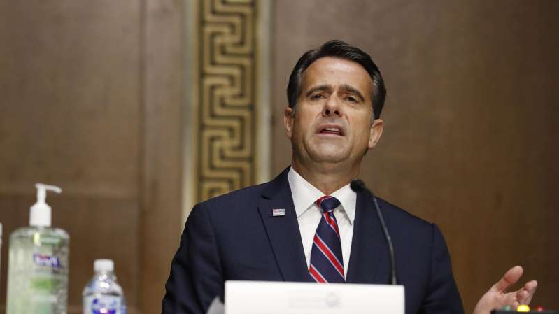 Rep. John Ratcliffe wearing a suit and tie: Director of National Intelligence John Ratcliffe testifies before a Senate Intelligence Committee nomination hearing on May 5, 2020, in Washington, DC.