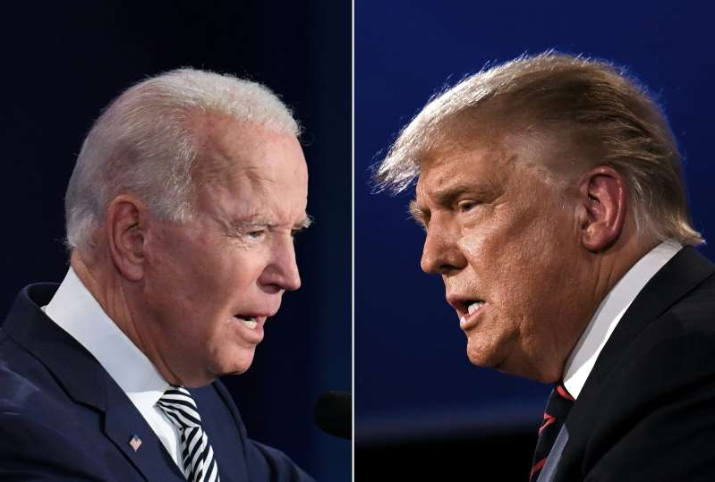 Joe Biden wearing a suit and tie: This combination of pictures created on Sept. 29, 2020, shows President Donald Trump and former Vice President Joe Biden squaring off during the first presidential debate at the Case Western Reserve University and Cleveland Clinic in Cleveland, Ohio.