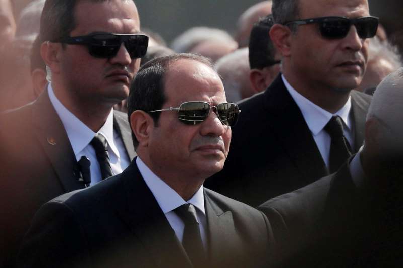 Abdel Fattah el-Sisi wearing sunglasses and a suit and tie: FILE PHOTO: Egyptian President Abdel Fattah al-Sisi attends the funeral of former President Hosni Mubarak east of Cairo