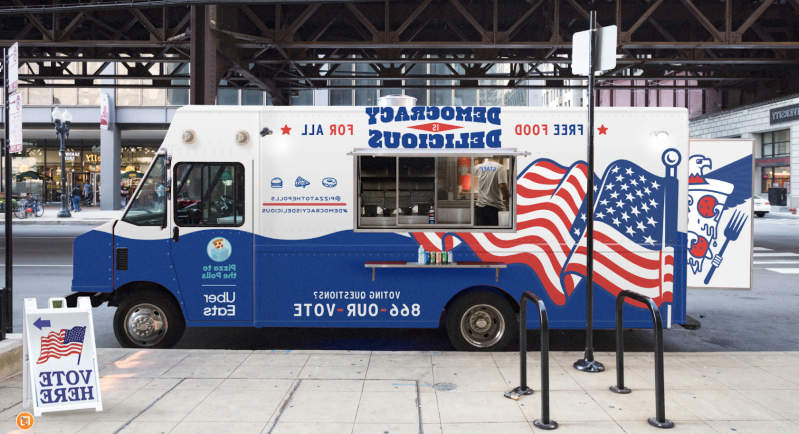 a blue truck parked on the side of a building: uber eats pizza to the polls