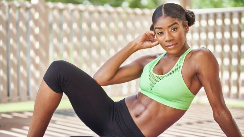 a woman with a racket: Best abs exercises for women