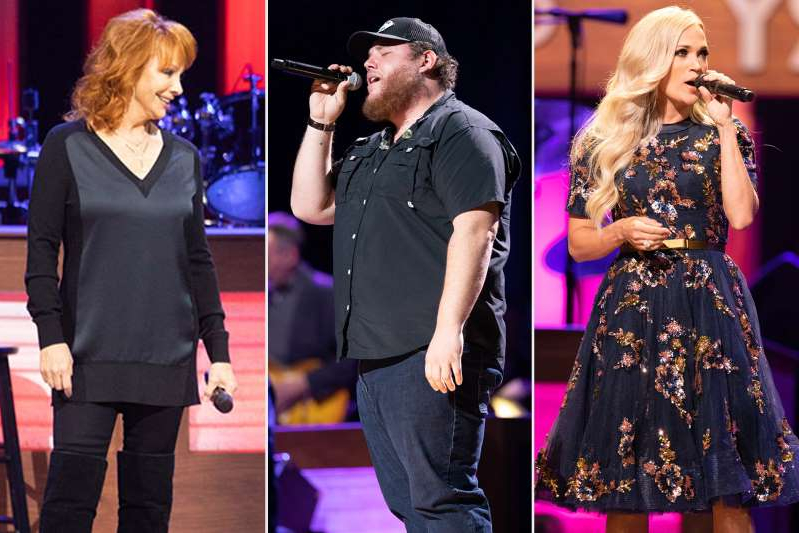 Carrie Underwood standing on a stage: Reba McEntire, Luke Combs, Carrie Underwood, Trisha Yearwood and more reveal their favorite moments, unforgettable flubs and backstage surprises. (Guess who swatted Carrie's behind!)