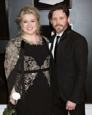 "Brandon Blackstock, Kelly Clarkson are posing for a picture: Keeping it real. Kelly Clarkson surprised some when she filed for divorce from Brandon Blackstock on June 4, 2020, after nearly seven years of marriage. At the time, a source exclusively told Us Weekly that the former couple ""clashed on so many levels and being in quarantine together [amid the coronavirus pandemic] heightened their problems to the point of no return."" The insider added that the pair, who tied the knot in October 2013 and later welcomed two children, daughter River Rose and son Remington, ""definitely didn't"" have a perfect marriage. ""Brandon's very laid-back, whereas Kelly's pretty high-strung,"" the source explained. The former American Idol winner made it clear in April 2015 that Blackstock wasn't her ""other half,"" noting that the two did, however, have a lot in common. ""He's a whole and I'm a whole,"" the ""Miss Independent"" singer told Redbook at the time. ""I've never believed in someone taking care of me, and that's probably because I grew up poor and without a lot of family stability."" Clarkson added: ""We put each other first. I call it the oxygen-mask mentality — take care of yourself first!""     Since calling it quits, Clarkson has been even more open about her dynamic with her estranged husband and how she's feeling amid the breakup. ""I mean, it's no secret. My life has been a little bit of a dumpster,"" the Grammy winner said in September during an interview on Sunday Today With Willie Geist. ""Personally, it's been a little hard the last couple months."" When it comes to their family, however, the Voice coach has vowed to use discretion. In addition to their two children, Blackstock is father of two children, Savannah and Seth, from his previous marriage to Melissa Ashworth. ""What I am dealing with is hard because it involves more than just my heart. It involves a lot of little hearts,"" the ""Already Gone"" singer said during the season 2 premiere of The Kelly Clarkson Show in September. ""We have four kids and divorce is never easy. We're both from divorced families, so we know the best thing here is to protect our children and their little hearts."" Scroll down to see what the ""Since U Been Gone"" singer has said about her split from Blackstock."