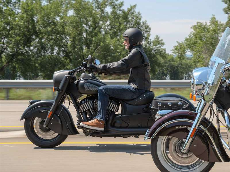 a man riding on the back of a motorcycle: Indian has announced its models for 2021, with the new Vintage Dark Horse leading the charge. The regular Vintage model is to the left.