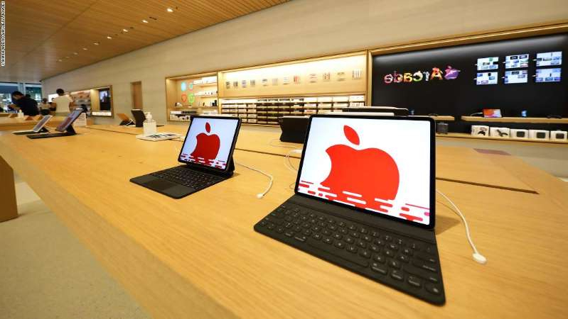 a screen shot of an open laptop computer sitting on top of a desk: Apple products are displayed inside the new Apple store at Marina Bay Sands on September 10, 2020 in Singapore. The store located in a futuristic giant glass orb is the third Apple store to open in Singapore. (Photo by Suhaimi Abdullah/Getty Images)