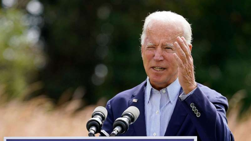 Joe Biden wearing a suit and tie: Democratic presidential candidate and former Vice President Joe Biden speaks about climate change and wildfires affecting western states, Sept. 14, 2020, in Wilmington, Del.
