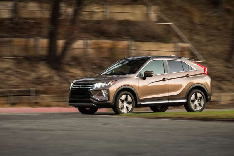 a car parked on the side of a road: The Eclipse Cross isn't a crossover that sells very quickly. Sam Bendall/Roadshow