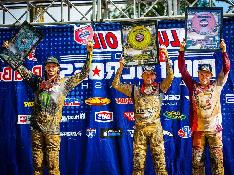 a group of men posing for a picture: Two-time Lucas Oil AMA Pro Motocross 250 Class champion Jeremy Martin (middle) captured his first overall victory since 2018 when he suffered a severe back injury at the Muddy Creek National.