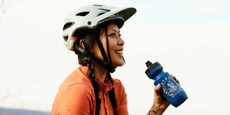 a person wearing a hat: Prep that protein shake for after your next long ride for muscle-boosting benefits.
