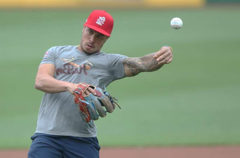 a baseball player throwing a ball: The St. Louis Cardinals will try to sign second baseman Kolten Wong to a new deal.