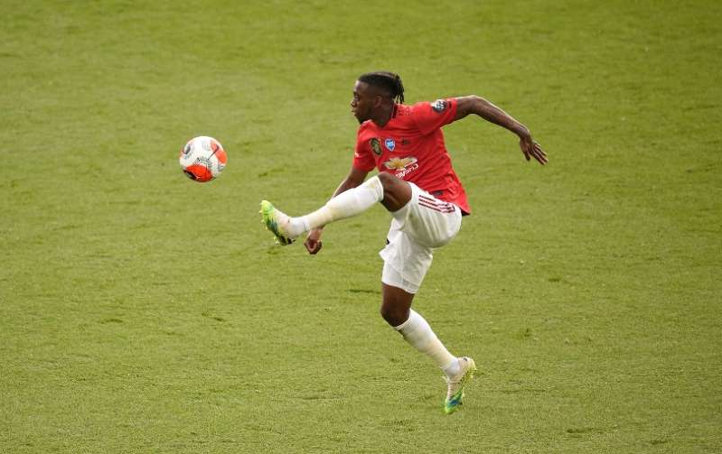 a man with a football ball: Aaron Wan-Bissaka, England and Manchester United