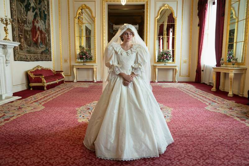 a person in a wedding dress: Season 4 of the British royal family drama will premiere Nov. 15 on Netflix.