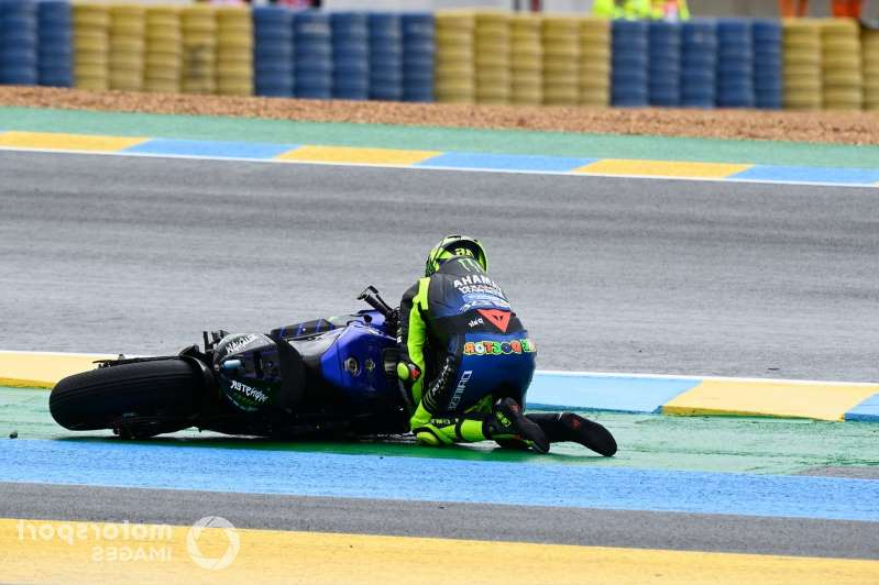 a person riding a motorcycle on the side of a road: Valentino Rossi, Yamaha Factory Racing crash