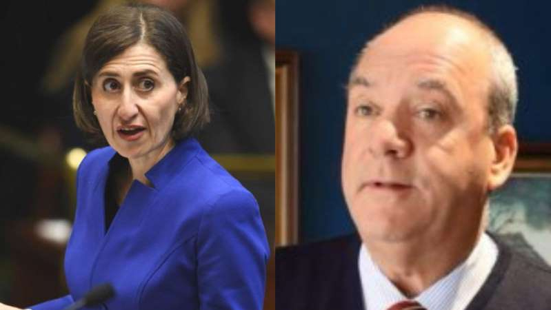 Gladys Berejiklian wearing a suit and tie smiling at the camera: The Premier has told ICAC she maintained a close relationship with Mr Maguire until recently. (Supplied ABC News)