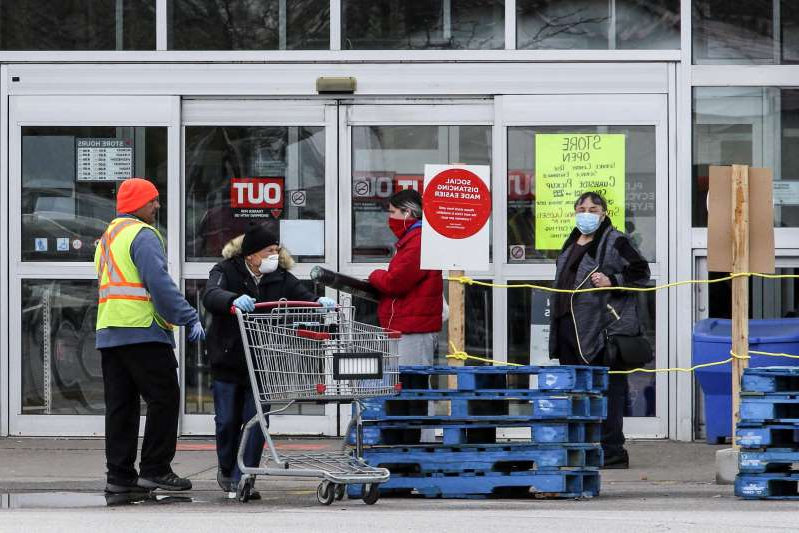 TORONTO, ON - MAY 11: Customers wait to enter a Canadian Tire Store at 2129 St. Clair Ave. W. on May 11, 2020. Stores retail businesses are opening to the public after being closed to help stop the spread of COVID-19.        (Andrew Francis Wallace/Toronto Star via Getty Images)