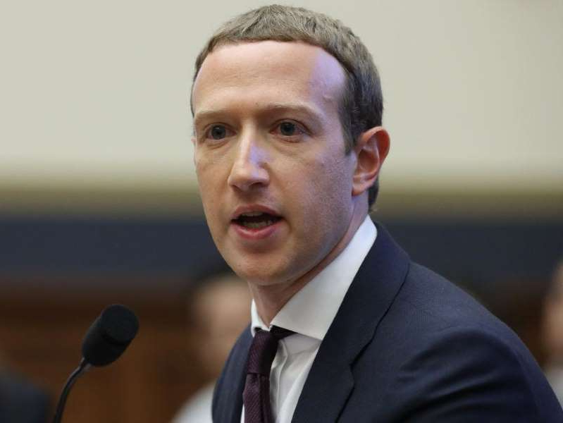 Mark Zuckerberg wearing a suit and tie: Facebook co-founder and CEO Mark Zuckerberg testifies before the House Financial Services Committee in the Rayburn House Office Building on Capitol Hill October 23, 2019 in Washington, DC.