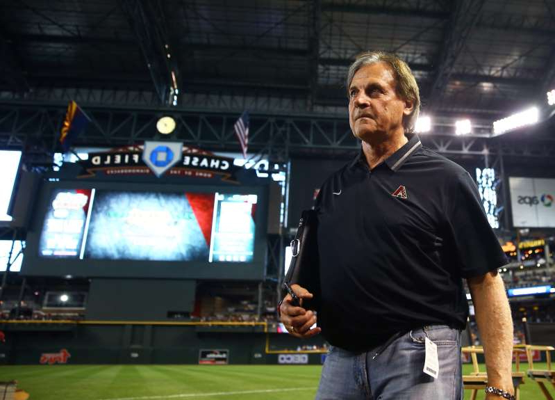Tony La Russa standing on a stage playing a video game: Tony La Russa last managed in the major leagues in 2011.