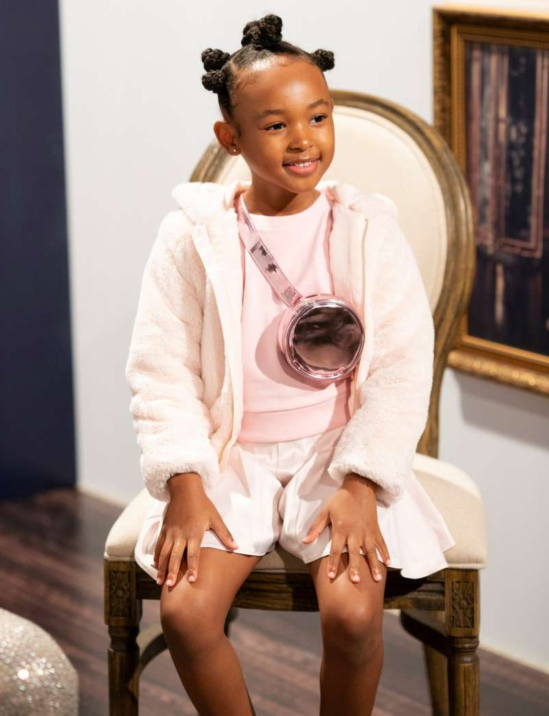a person sitting on a table: Zhuri James hosts the launch of Janie and Jack x Harlem's Fashion Row