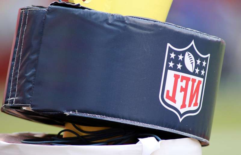 a piece of luggage: A close up an NFL football logo on a goalpost during an NFL football game between the Los Angeles Rams and Washington Football Team, Sunday, Oct. 11, 2020 in Landover, Md.
